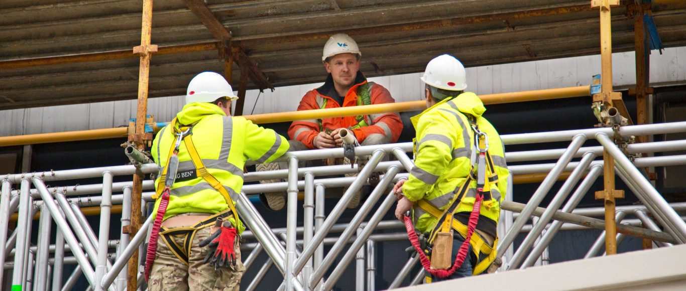 Photo of people in high-vis jackets at a construction site