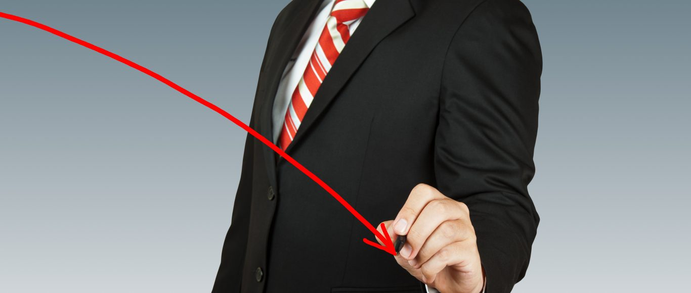 Photo of a man drawing an arrow on the screenpointing downwards