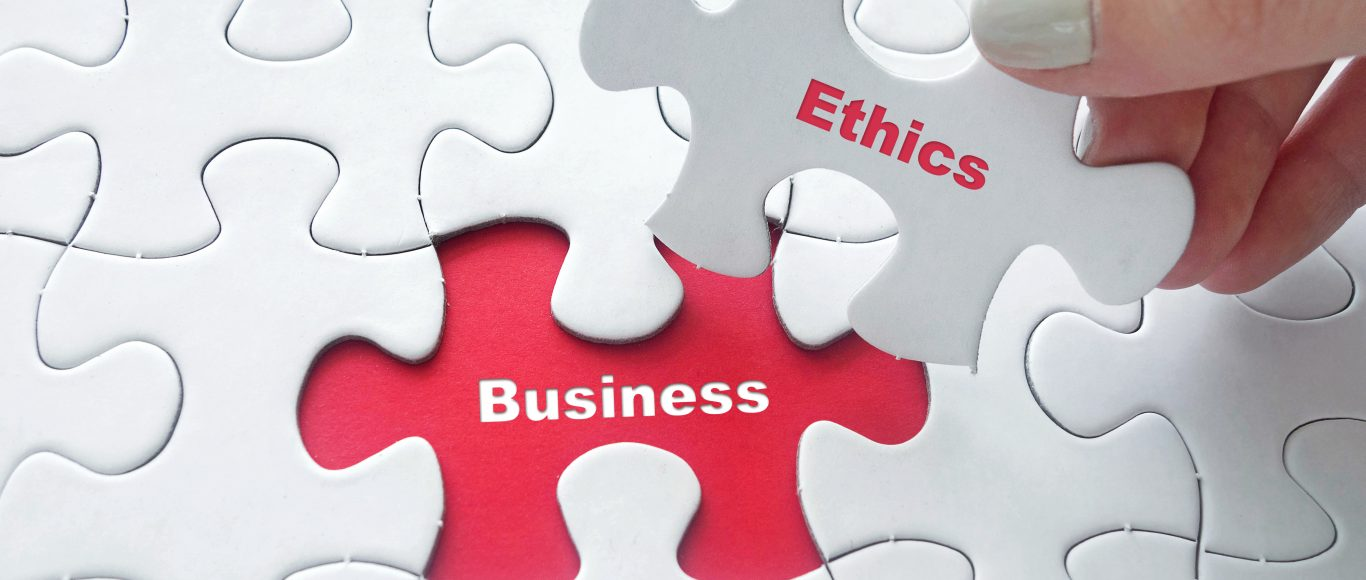 Photo of a puzzle piece saying 'ethics' replacing a piece saying 'Business'