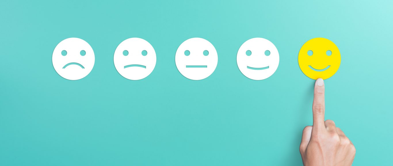 Photo of a line of faces progressing from sad to happy