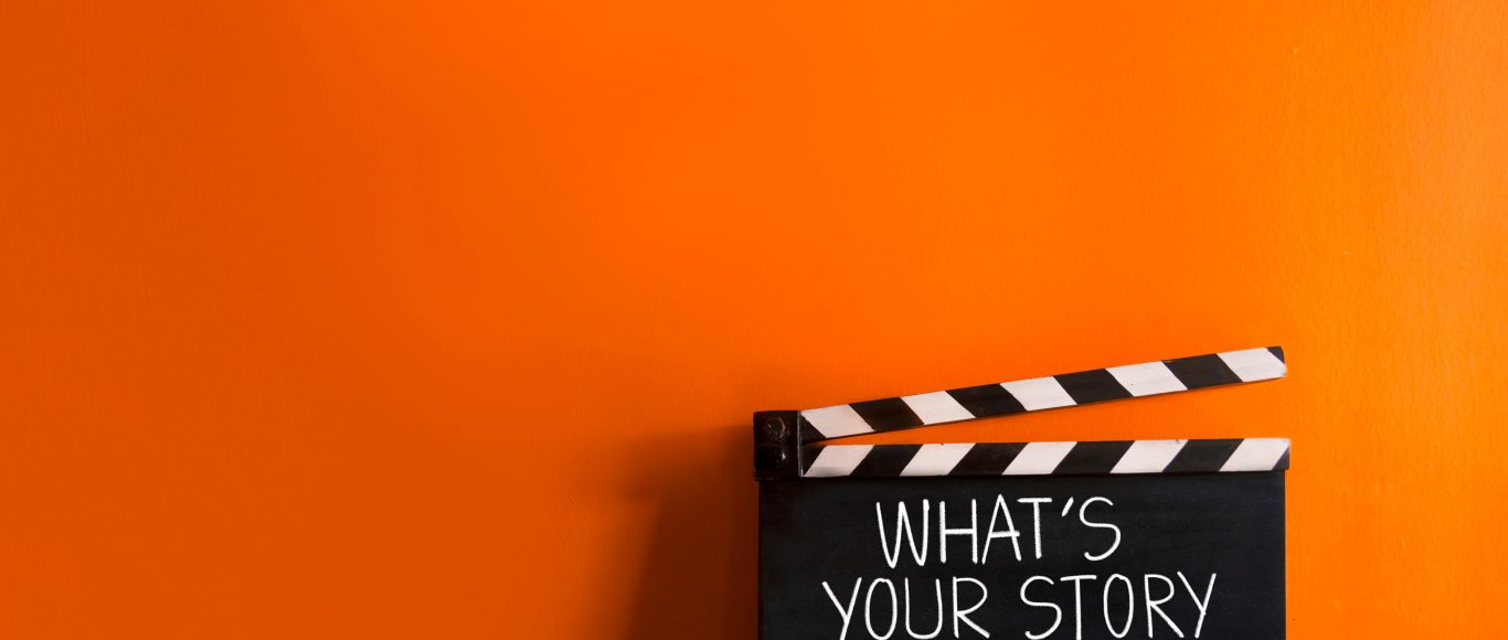 Photo of movie storyboard with text 'what's your story'