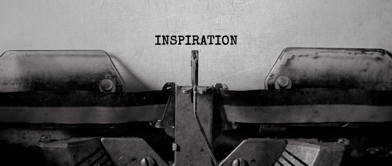 An image of a typewriter with the word inspiration written above