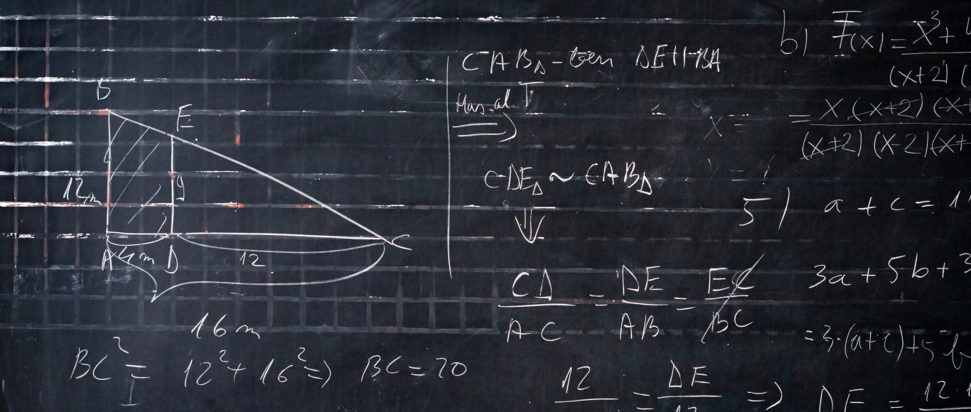 Photo of a blackboard full of science equations