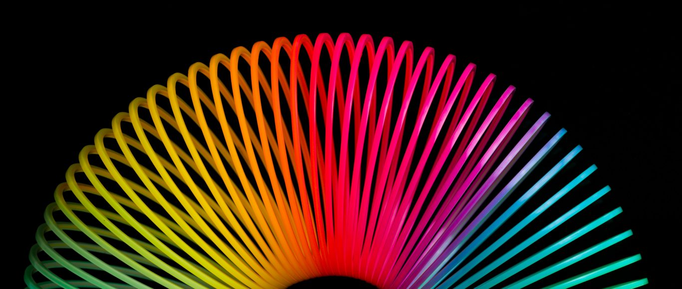 Photo of a multi-coloured slinky toy