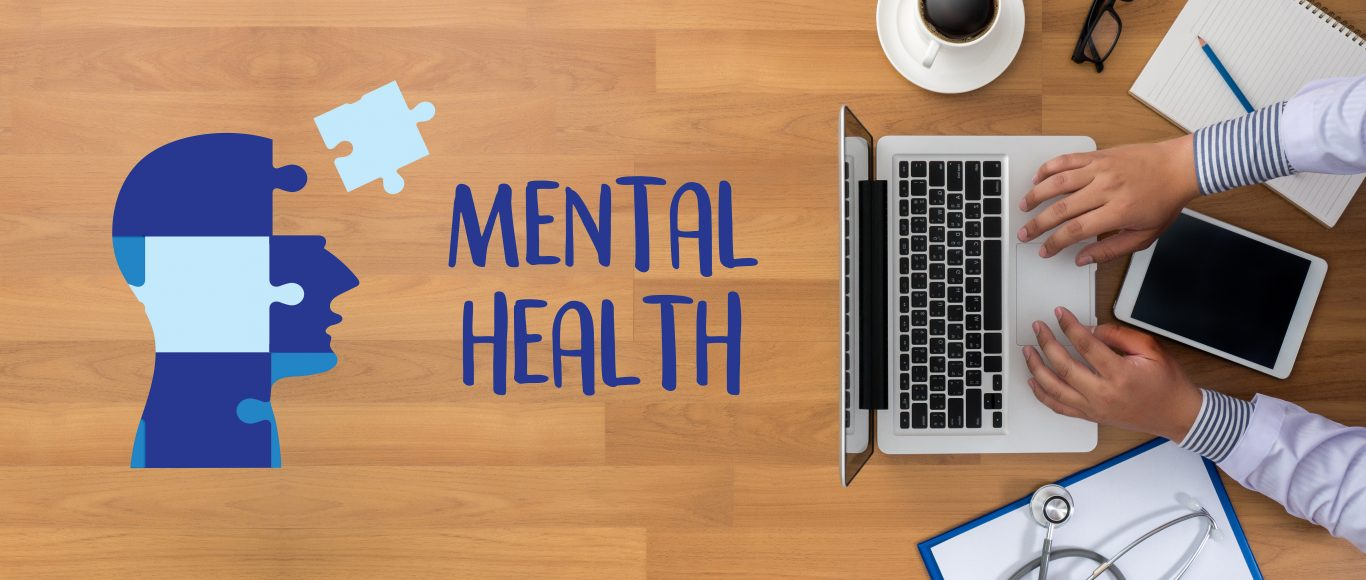 Photo of someone at their laptop, next o words saying 'mental health' and a head made of puzzle pieces