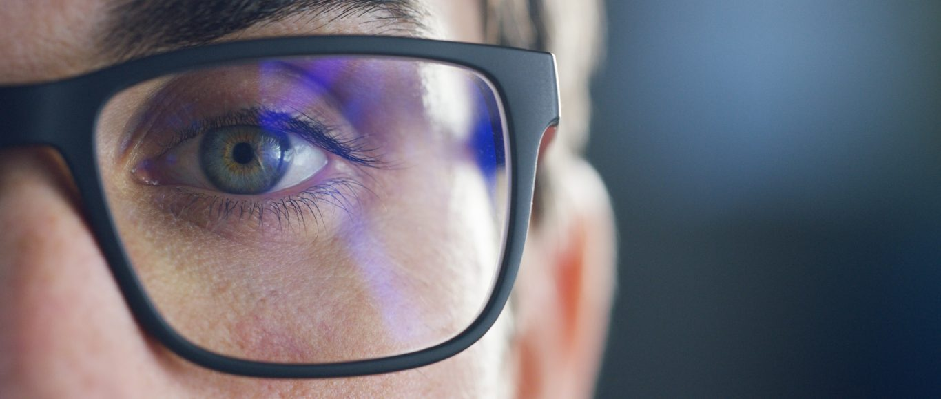 Photo of a close up of someones eye and glasses
