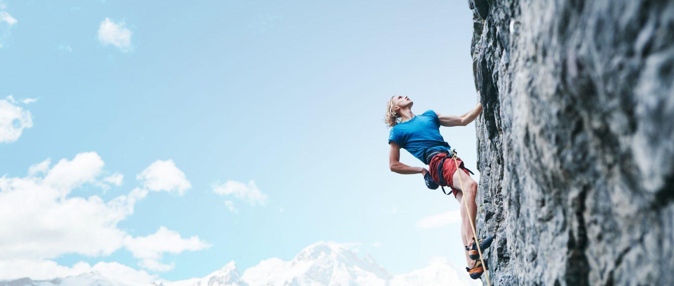 Photo of a lady rock climbing