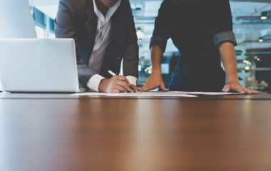 Photo of people working together at a desk