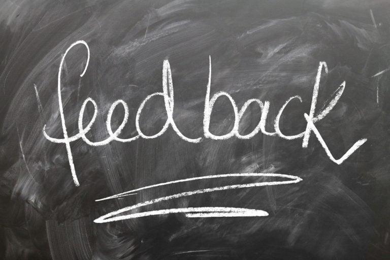 A blackboard with feedback chalked onto it