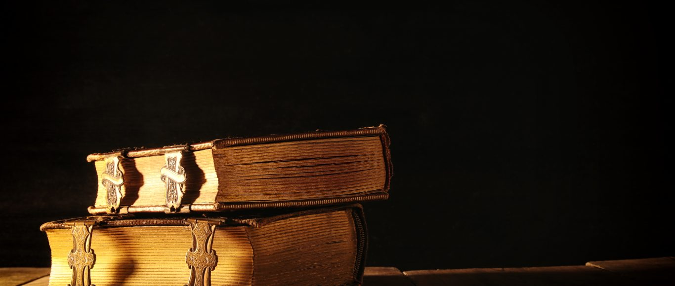 Photo of two books stacked on one another