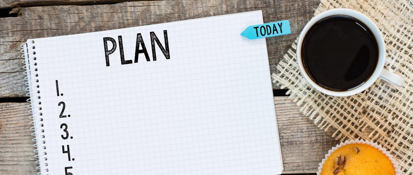 Photo with the word 'plan' written on a notepad