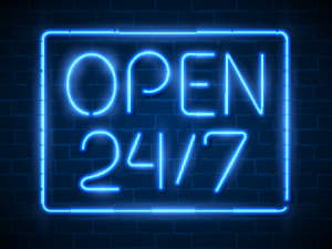 Photo of a sign that says 'Open 24/7@