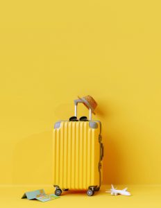 Photo of a bright yellow suitcase