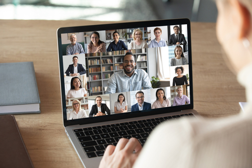 Photo of a team having a virtual meeting on a laptop