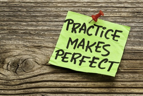 Practice makes perfect written on a post it note