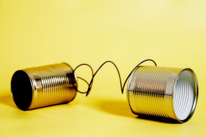 Photo of two tin cans attached with string