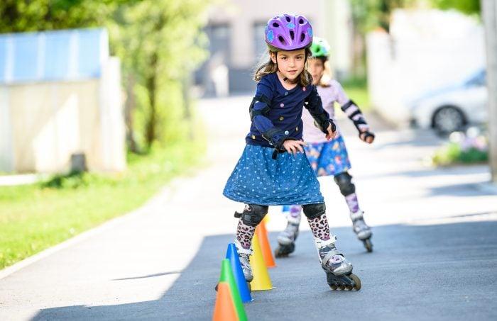 Photo of children rollerskating