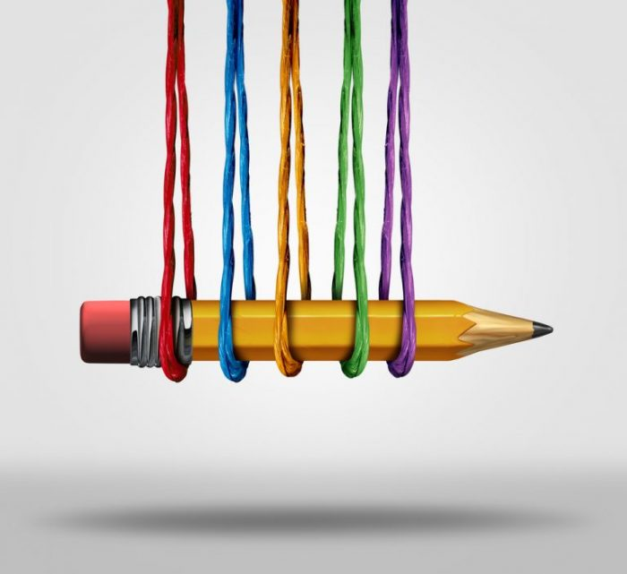 Photo of pencil being held up by coloured string