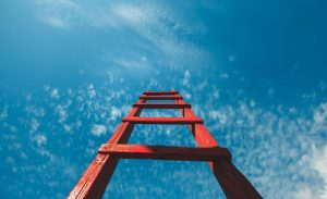 Photo of red ladder going up towards the sky