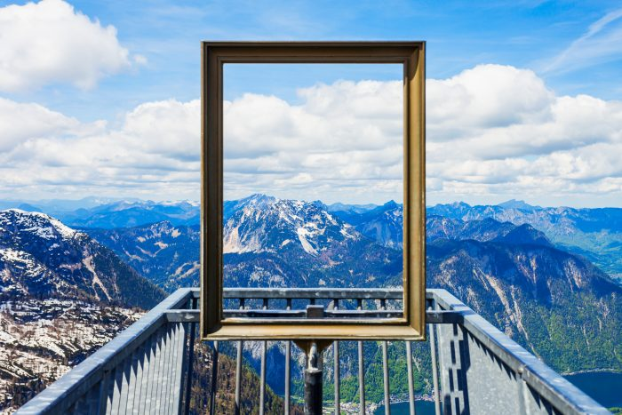 Photo looking through a picture frame into the mountains, like looking at another persons viewpoint