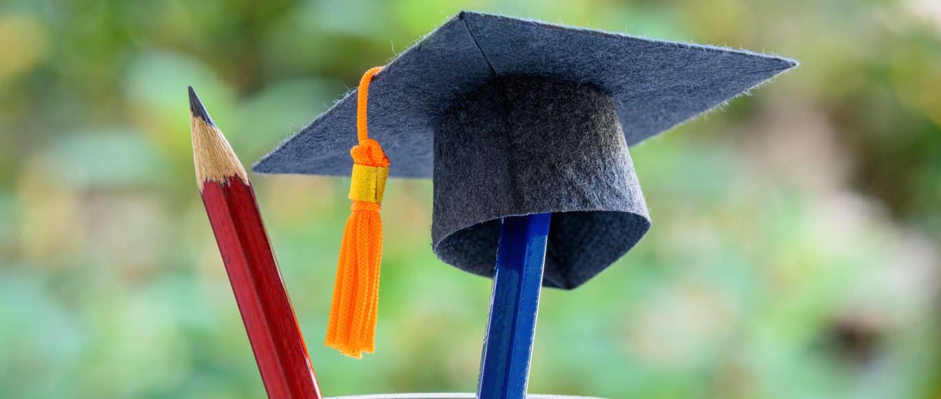 Photo of pencil and mortar board hat