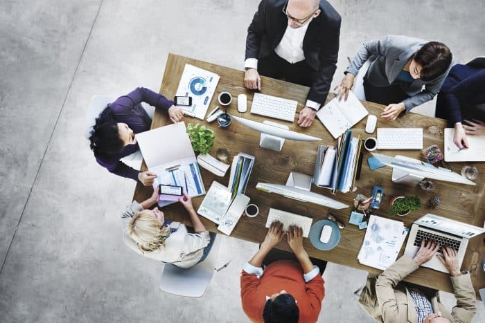 Photo of people working at a table