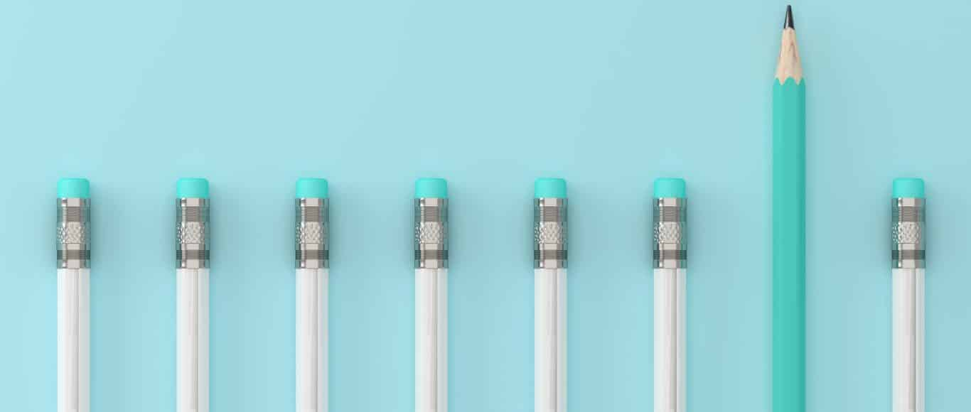 Photo of pencils in a line with one pushed out above the rest