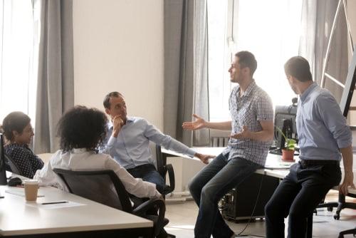 Team members talking and listening