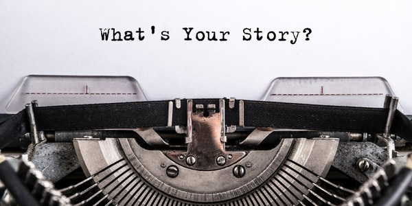 Photo of a typewriter with text of 'what's your story?