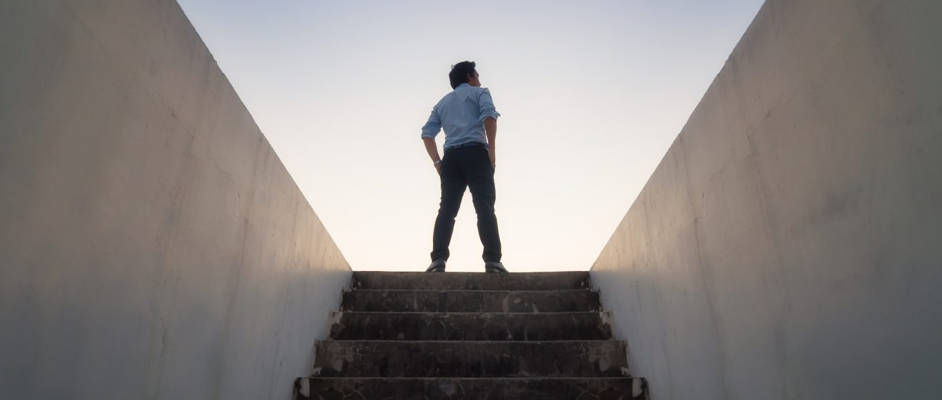 Photo of someone standing at the top of some stairs
