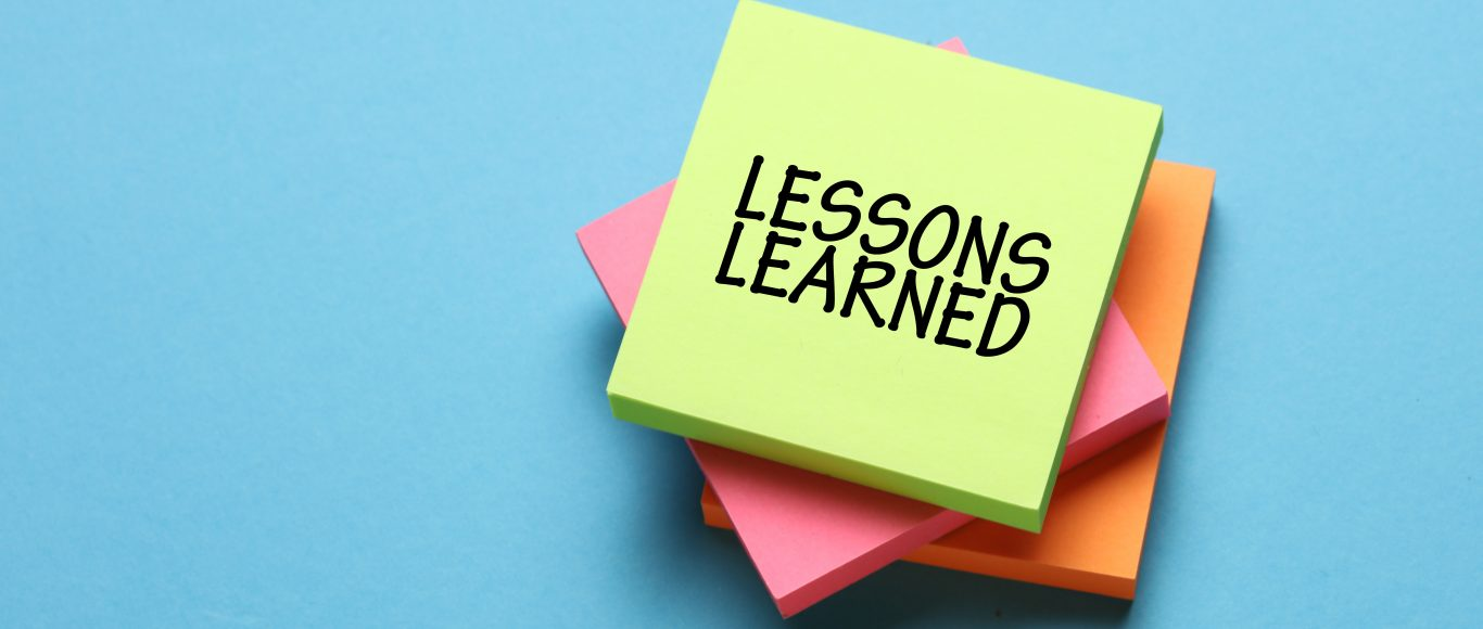 Photo of a post-it note saying 'Lessons Learned'
