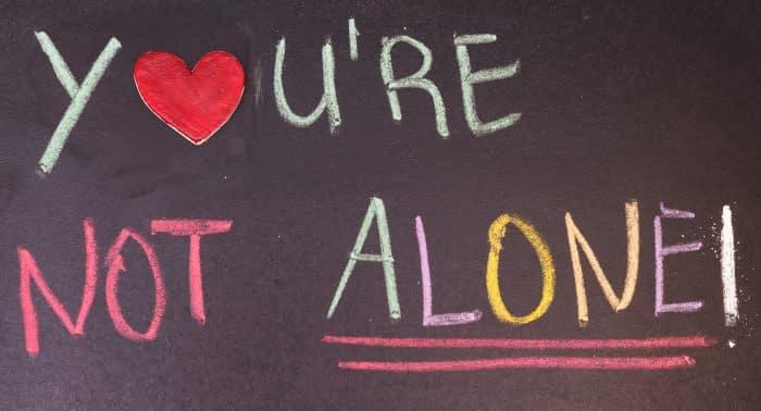 'You're not alone' written on a blackboard