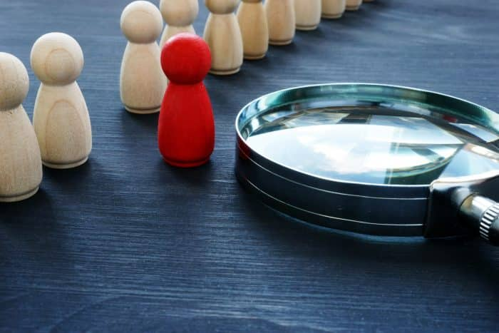 Photo of a magnifying glass and some game pieces
