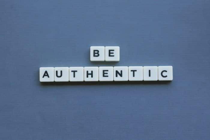 Photo of tiles that spell out 'BE AUTHENTIC'