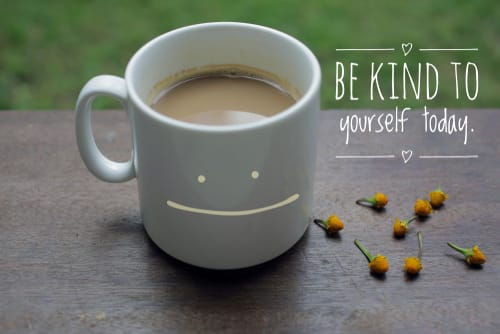 Photo of a mug and 'Be kind to yourself today' next to it