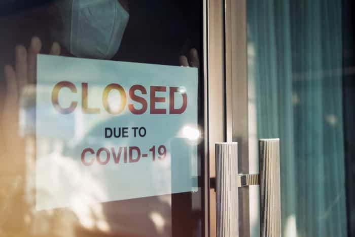 Photo of a shop sign that says 'Closed due to Covid-19'