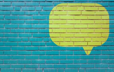 photo of painted speech bubble on brick wall