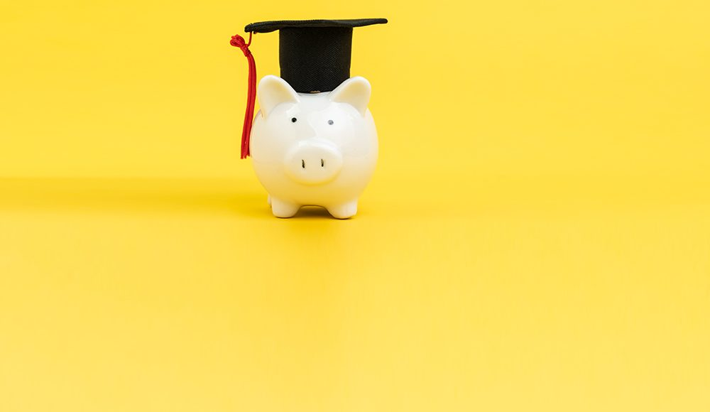 Photo of a piggy bank with graduation hat