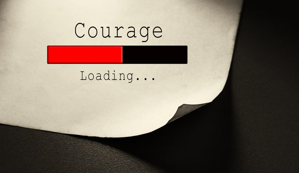 Photo of a loading bar with the word courage
